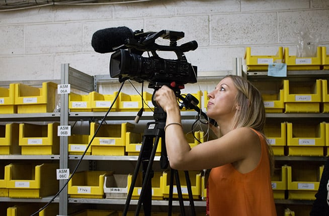 fiona filming in factory within news story