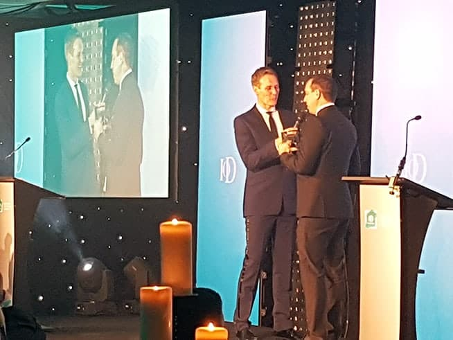 Barry receives his award from Dan Walker