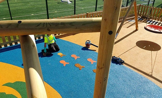 Laying the nautical themed wet pour safety surfacing